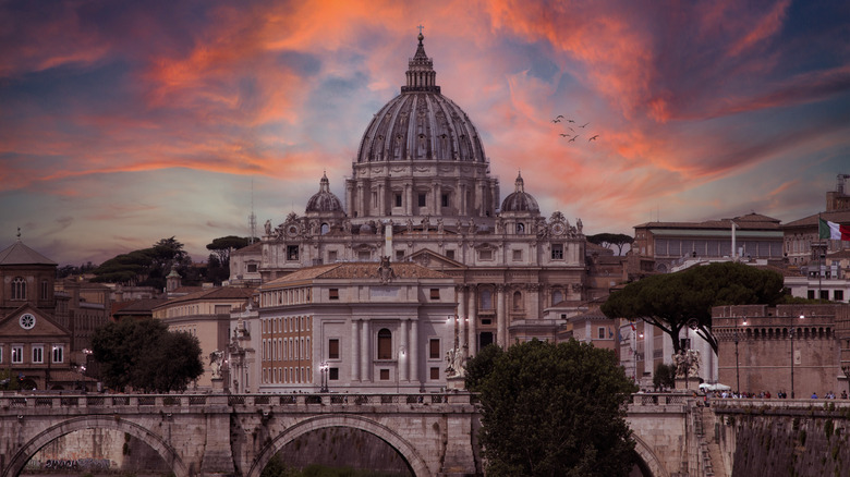 Vatican city under pink clouds