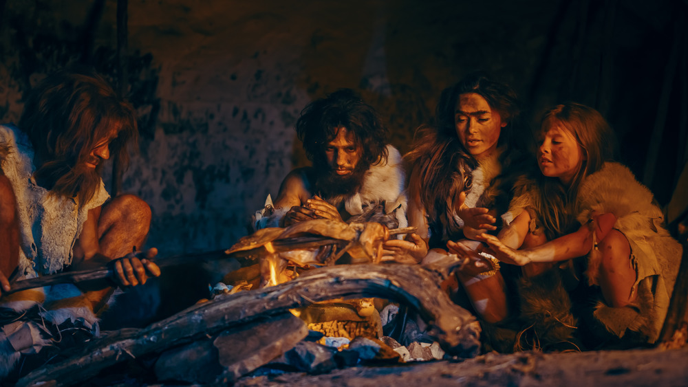 A recreation of an ancient family gathered together to eat meat