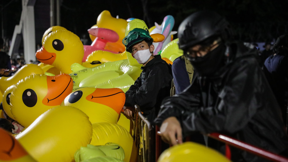 Protesters in Bangkok in 2020 using inflatable rubber ducks against the police