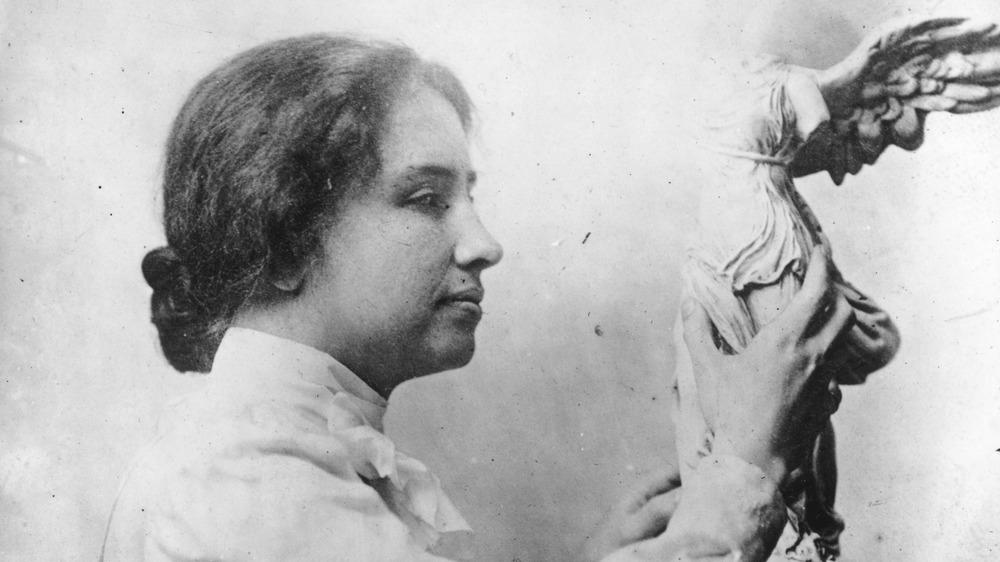Helen Keller holding statue