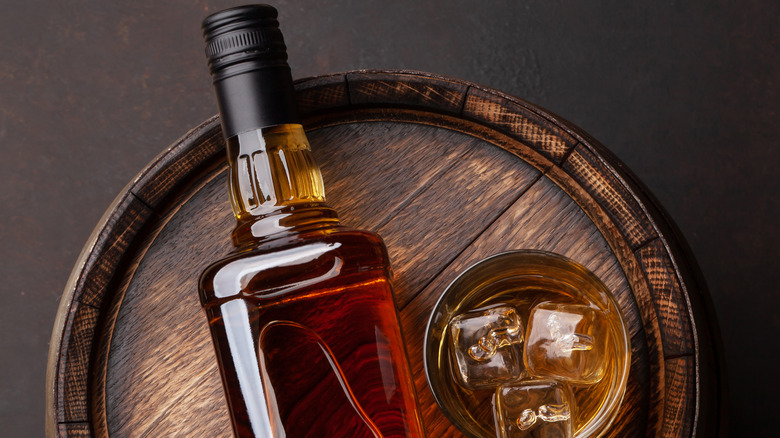 Bourbon bottle and glass