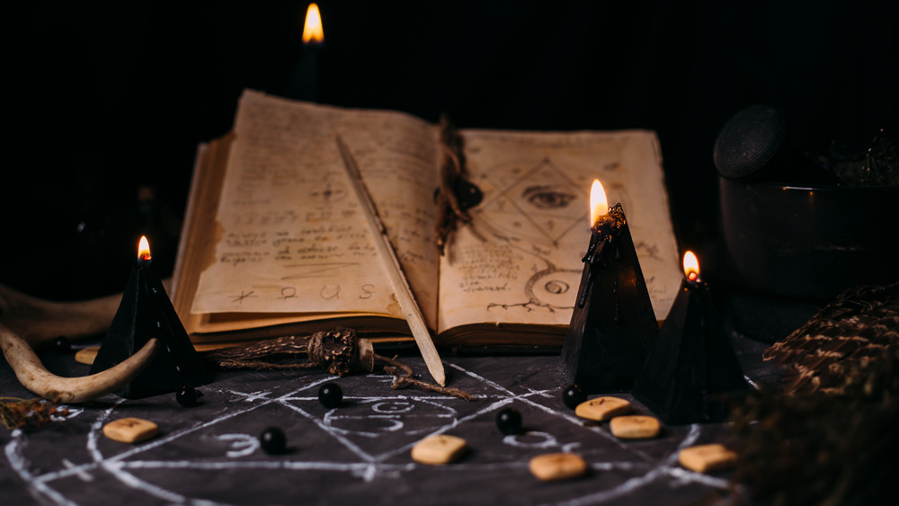 Spell book on a witch's alter