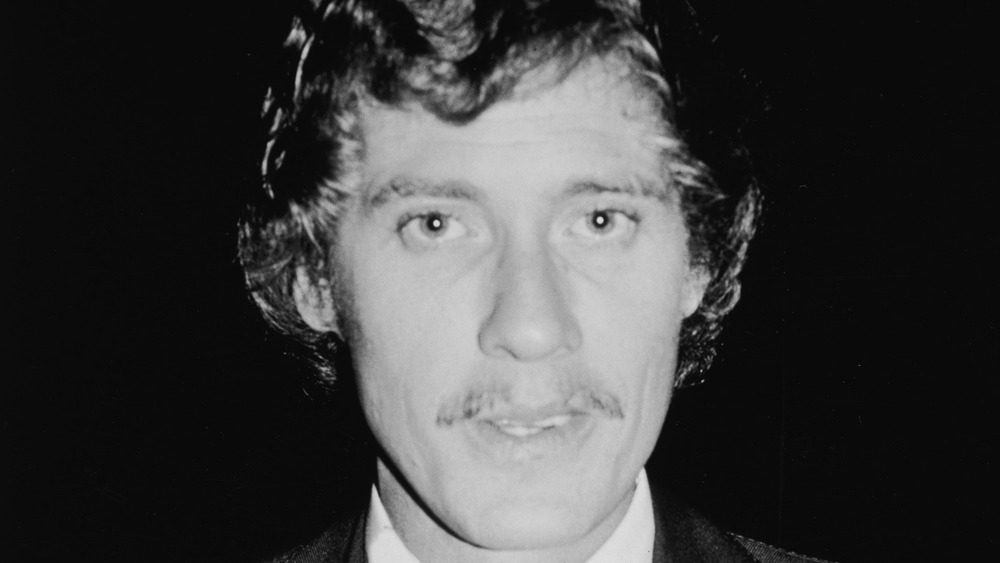 John Holmes in a suit