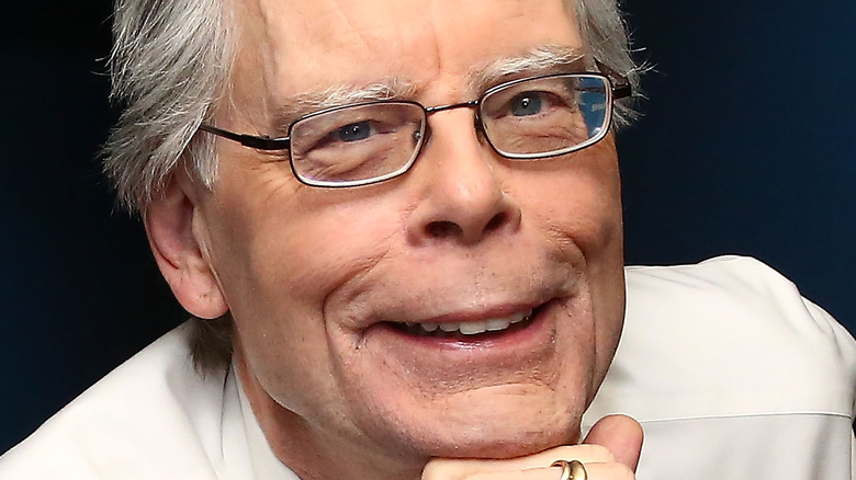 Stephen King posing for a photo