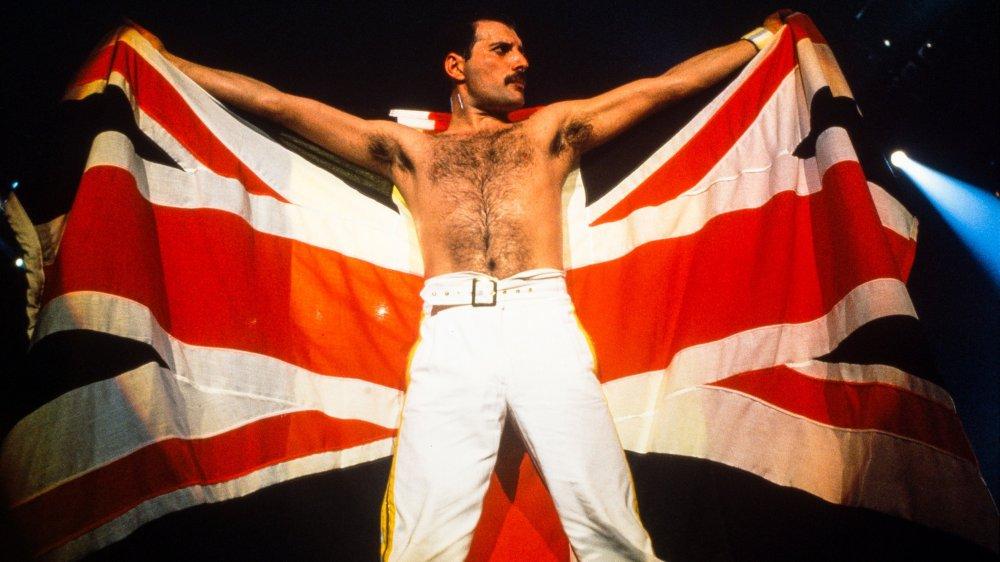 Freddie Mercury posing with flag