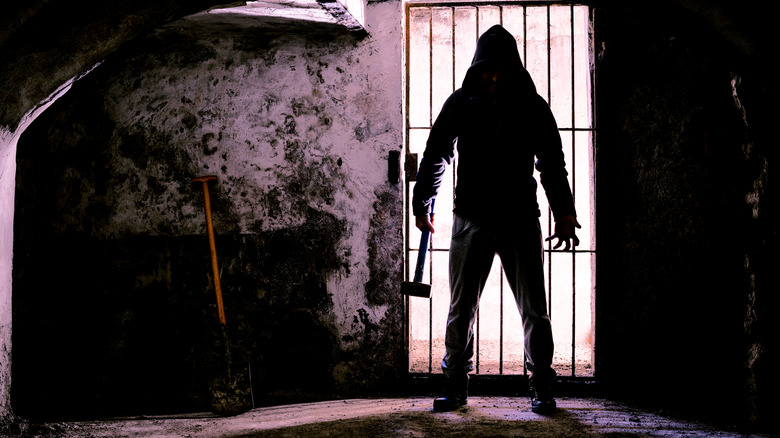 silhouette of Man in dungeon