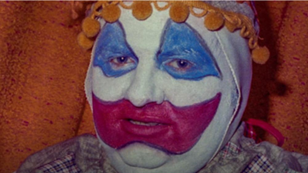 John Wayne Gacy in clown outfit