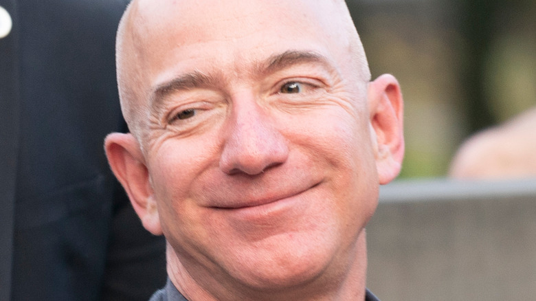 Jeff Bezos smugly thinking about how he can use the bathroom whenever he wants