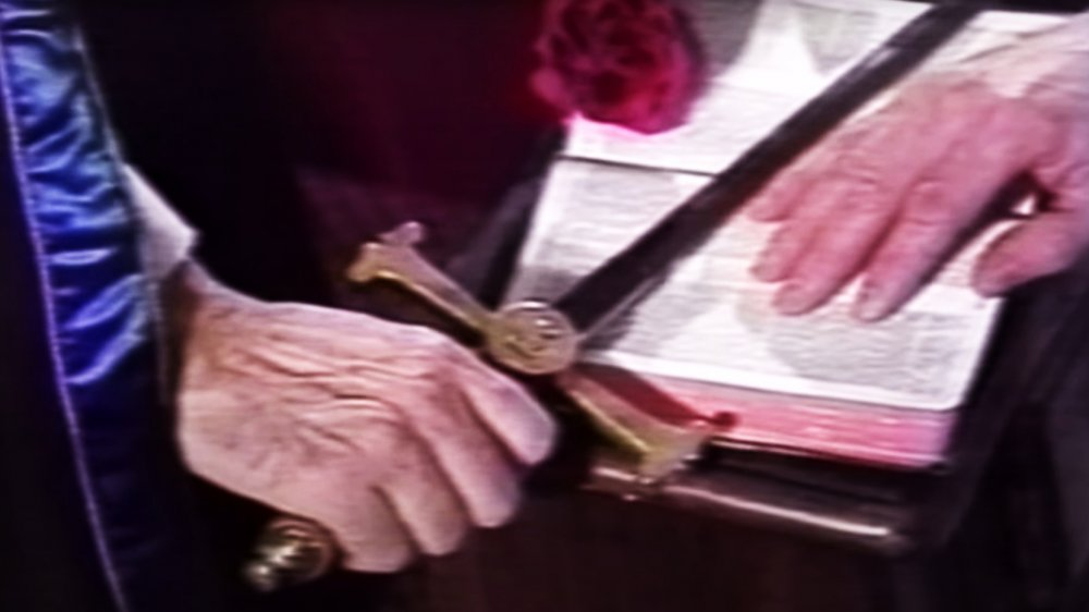 Closeup of sword and bible used by Order of the Solar Temple