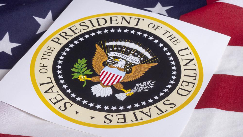 Presidential seal atop flag
