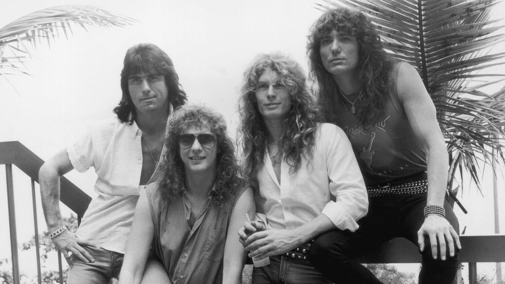 Whitesnake posing together outside