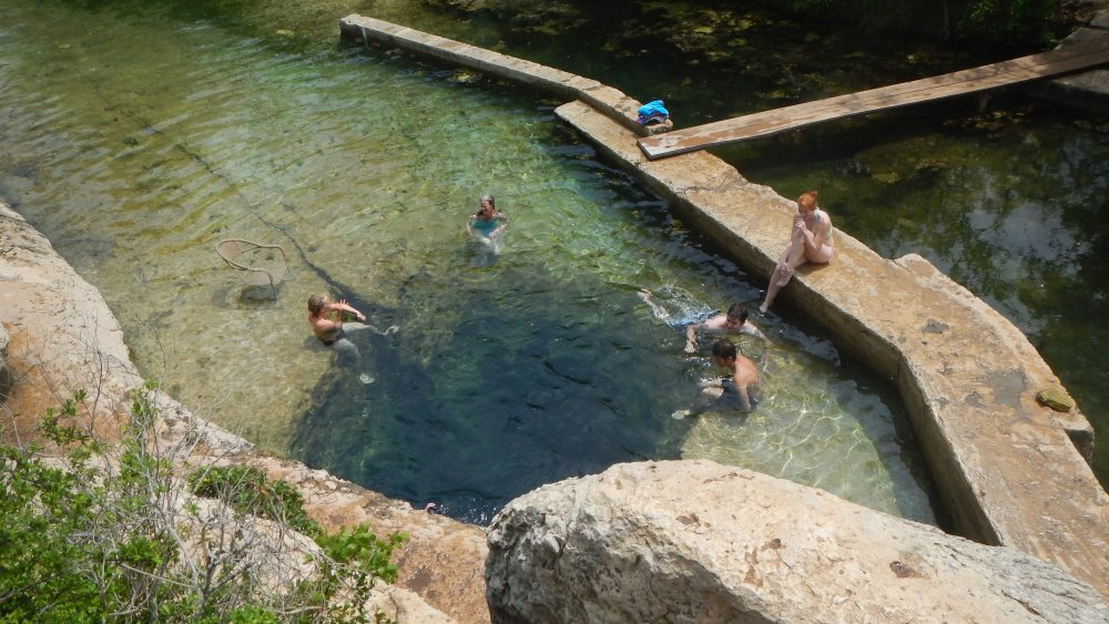 People swimming at Jacob's Well