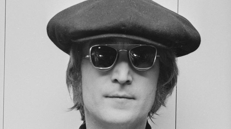 John Lennon posing for photo