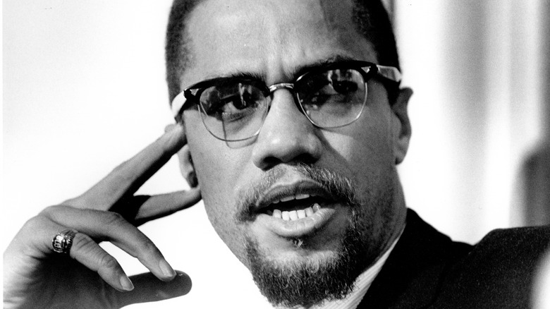 Malcolm X hand to temple
