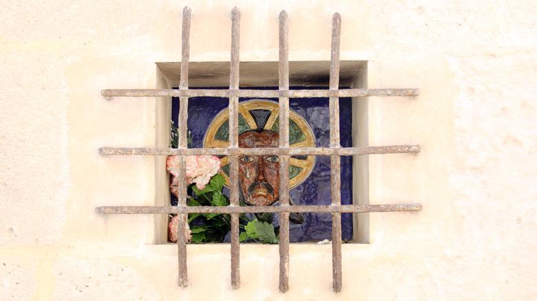 Portrait of Jesus behind bars