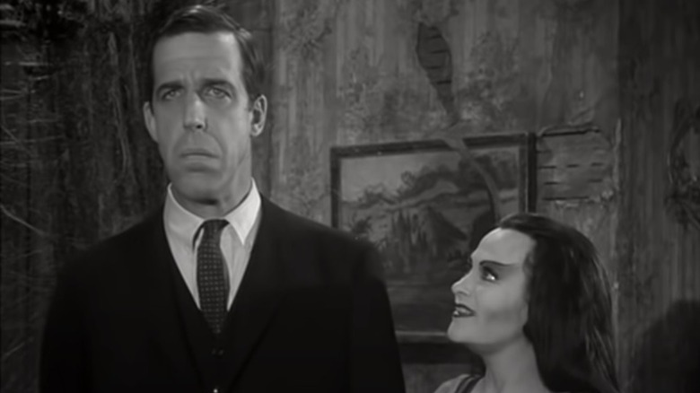 Herman and Lily Munster standing