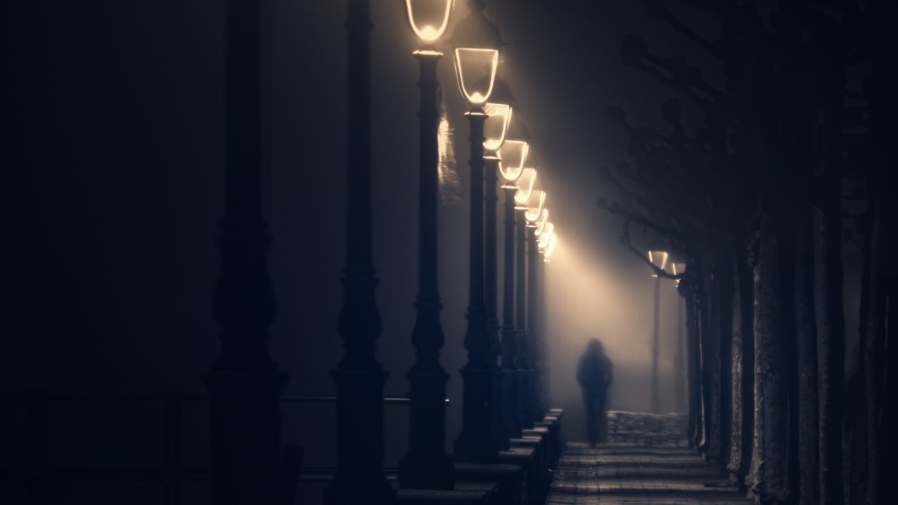 Man walking a dark street