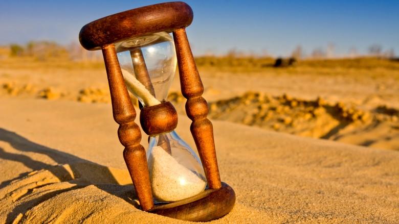 hourglass in desert field