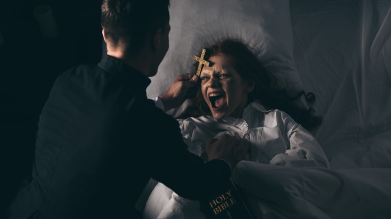 Priest performing an exorcism