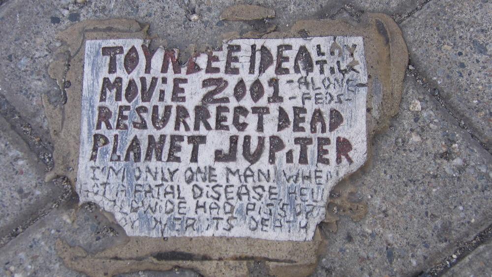 A Toynbee tile on asphalt