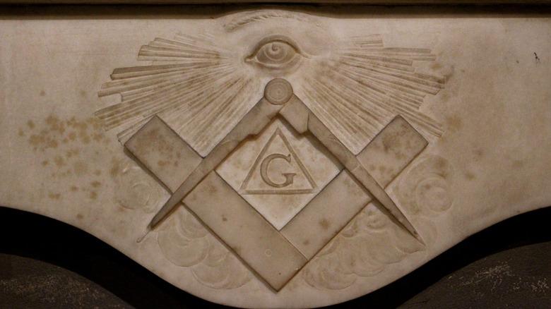 Freemasonry symbol carved into stone