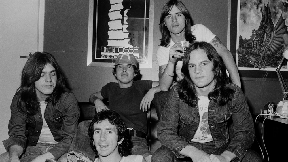 AC/DC members with mark evans