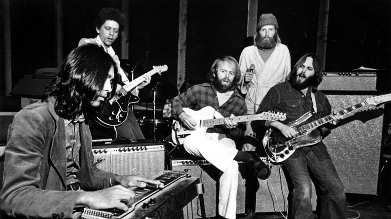 Ricky Fataar and Blondie Chapman performing with Al Jardine, Mike Love, and Carl Wilson of the Beach Boys