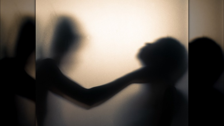 shadow strangling a person