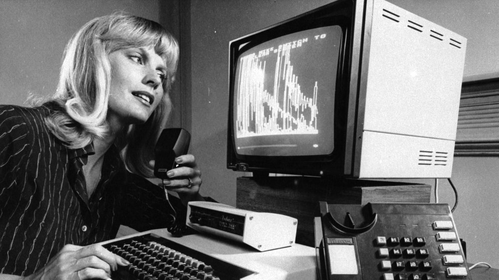 A woman using a computer in 1984