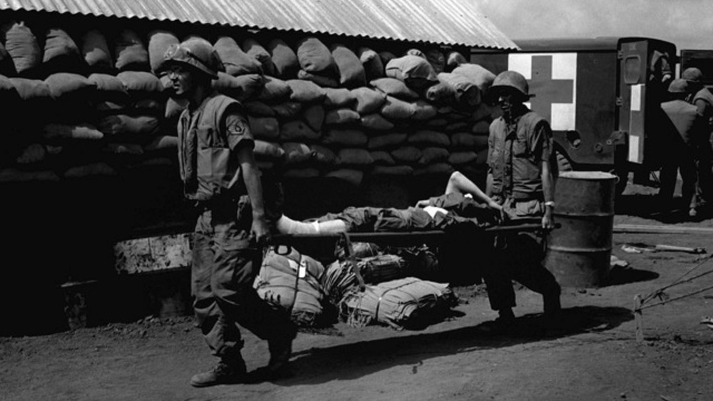 Air Force medics move a Marine casualty to a plane
