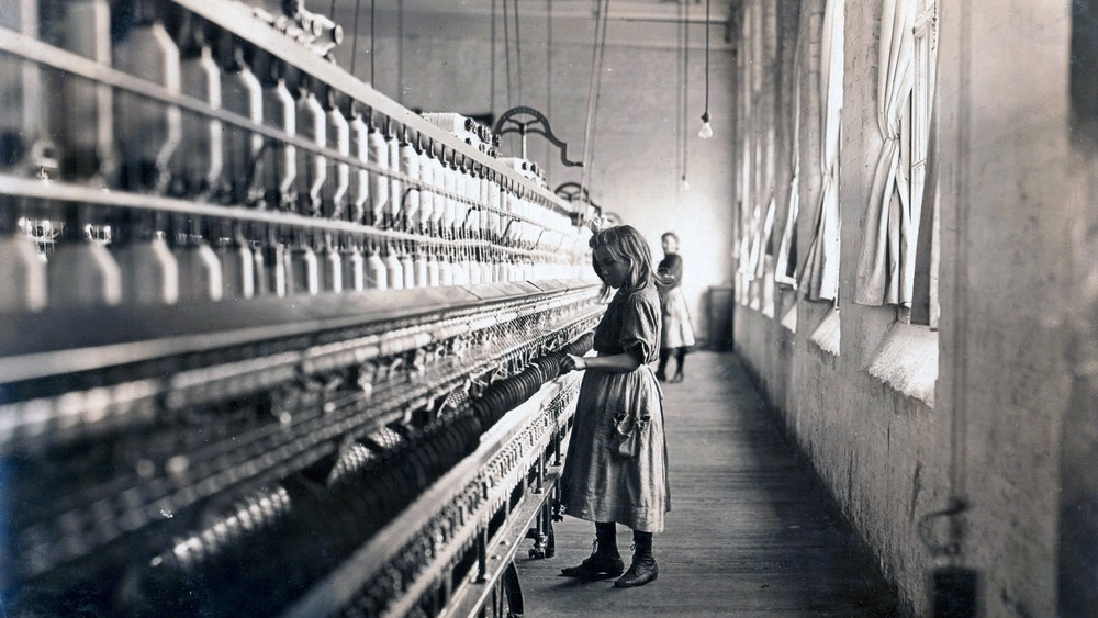 Child laborer at work in a cotton mill