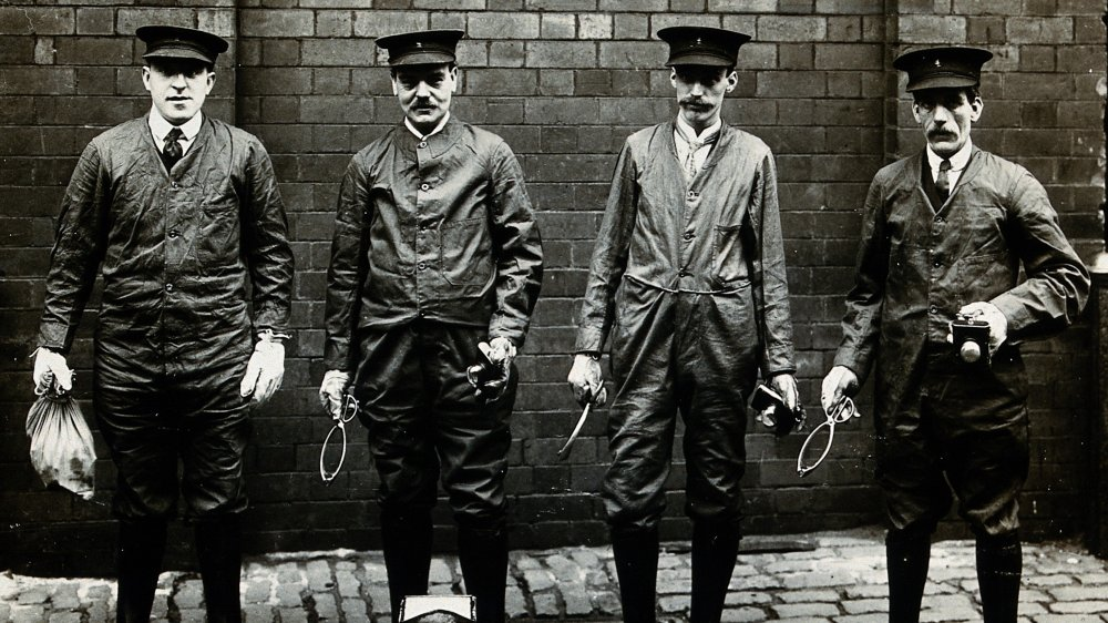 Professional rat-catchers lining up with the tools of their trade, Liverpool, England