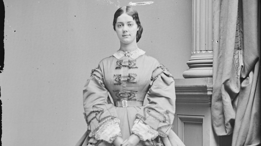Kate Chase Sprague, standing