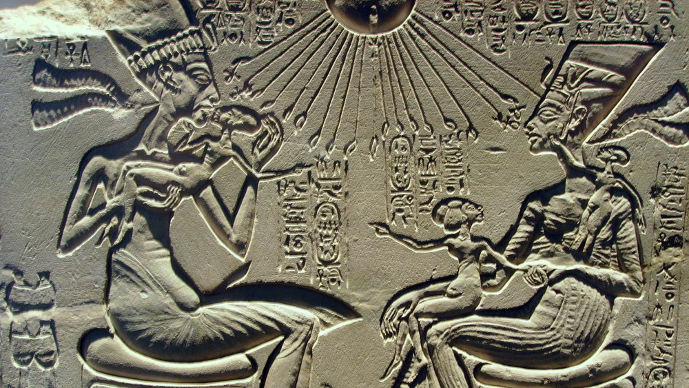 house altar showing Ancient Egyptian pharaoh Akhenaten, Nefertiti and three of their daughters