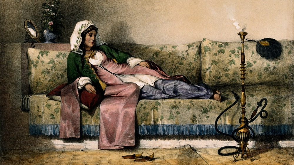 A Muslim lady reclining in her harem