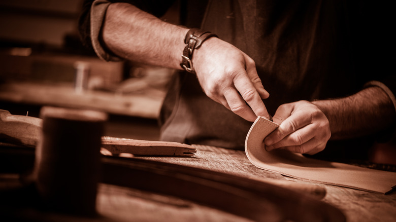 saddler working with leather