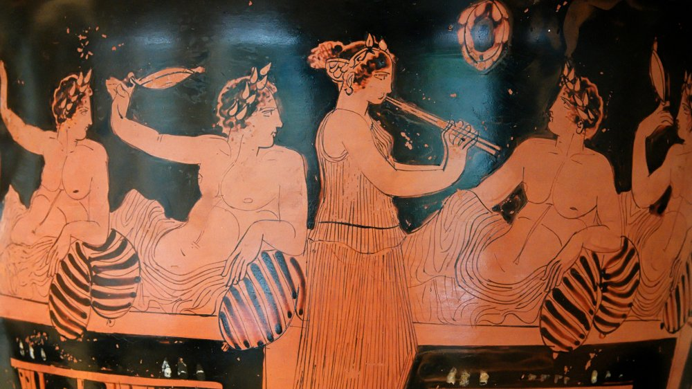 An image of an Ancient Macedonian woman at a symposium