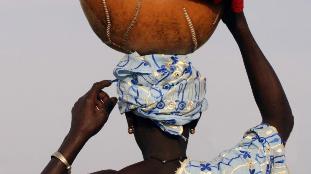 A Peul woman from Mali balancing a calabas on her head