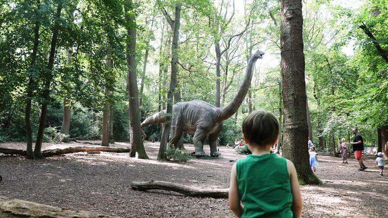 boy and dinosaur statue