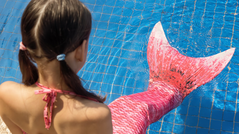 mermaid swimming in deep water