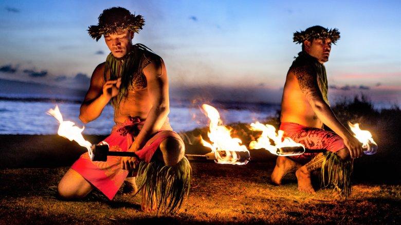 Hawaiian men prepare to swallow fire in Maui