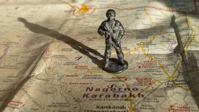 Soldier on map of Nagorno-Karabakh