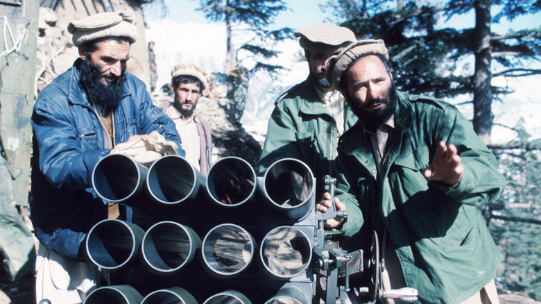 Mujahideen outside with weapons