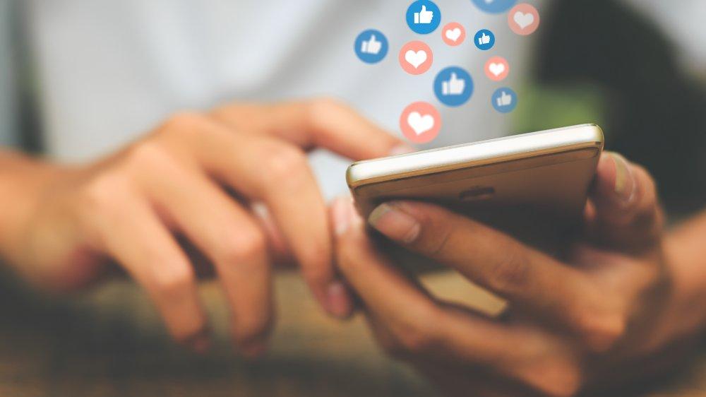 cell phone, social media, like icons, heart