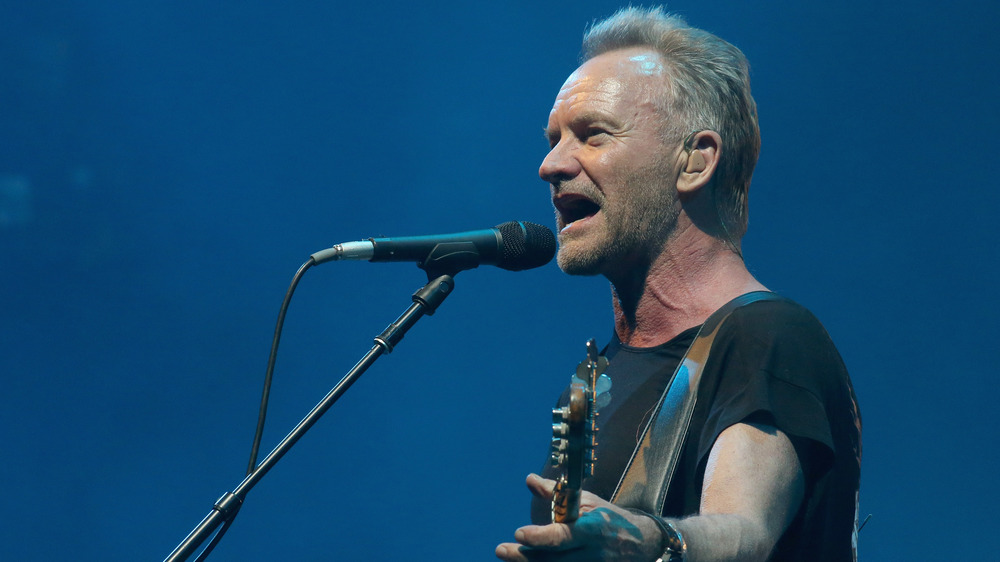 Sting performing onstage
