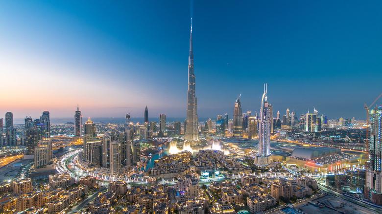 Burj Khalifa towering over other buildings in Dubai