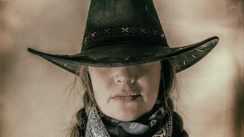 Woman in western hat