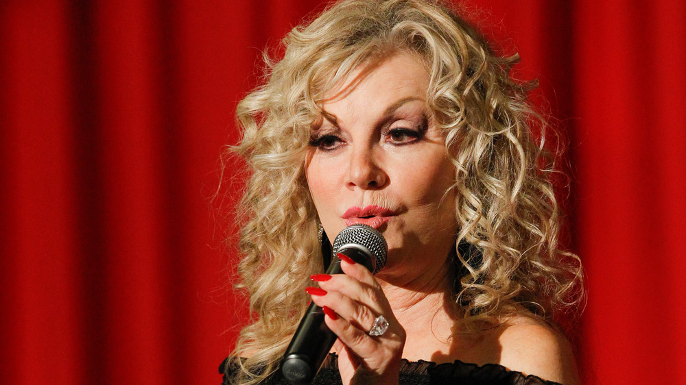 Stella Parton with microphone