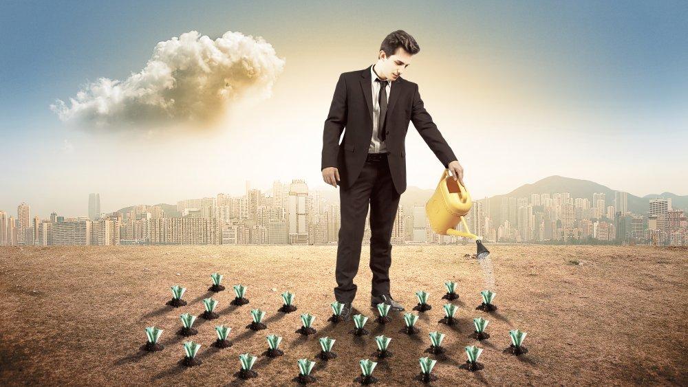 Rich man watering money