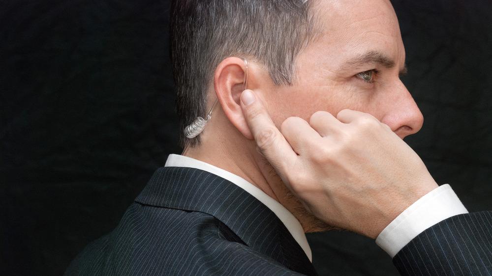 Secret Service agent listening on earpiece